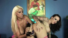Lusty blonde is eager to play with an inked young slut's pussy