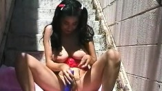 Hot Arlanza sets her big boobs free and plays with a sex toy outside