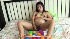 Pregnant Asian cutie likes to have colored balls around her when she toy fucks