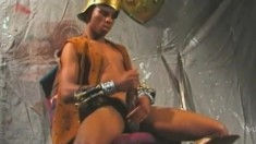 Black gladiator strokes his big pole until it explodes with pleasure