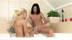 Luscious babes indulge in some exciting lesbian fucking in the bathtub