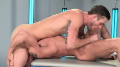Two muscled jocks suck their stiff pricks in a 69 and engage in hot anal sex