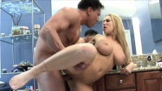 Horny blonde mom with big breasts takes a hard fucking in the bathroom
