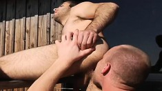 Hunky gay stud tongues and drills his boyfriend's lovely ass outside