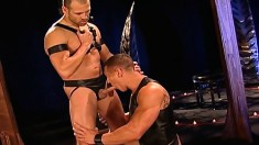 Kinky gay lovers share a big black dildo and engage in wild anal sex