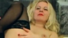 Mature slut in stockings uses sex toys