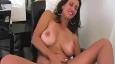 Voluptuous boss MILF dildo fucking her twat at the office