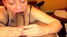 Short haired redhead milf does blowjob on her knees in POV
