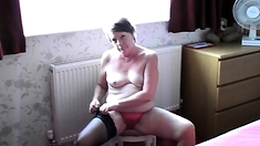 Small titted milf stripping off the bedroom