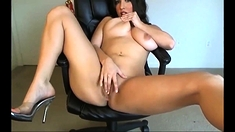 Busty milf toying her wet pussy