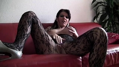 Mature gives a solo masturbation and stripping sex show
